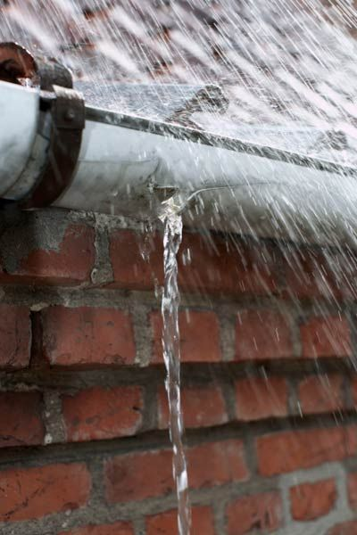 Got a hole in your gutter?  Here's how to patch it. | Photo: Kristian Septimius Krogh/Getty | thisoldhouse.com
