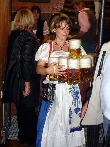 Oktoberfest waitresses demonstrating their mad skills