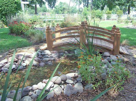 Garden water feature garden bridge water feature this for Garden pond bridge