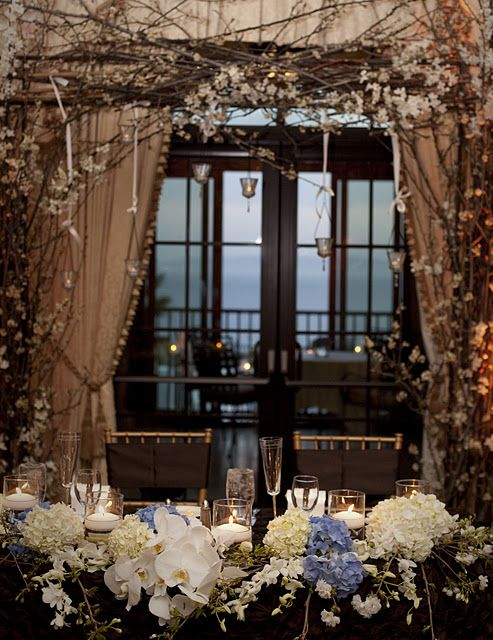 if you do have an arch for the ceremony, you can move it behind the head table afterwards to add to the decor in that area