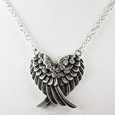 western girly | silver necklace , designed as two wings joined together - her mother ...