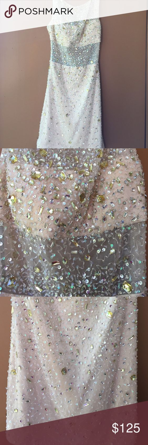 Bling-wow! Crystal-studded cocktail dress This is an eye-catcher. Don't know wear if you don't like attention. This dress comes fully embellished with rhinestones, crystals and sequins. A bling wow statement. Perfect for any birthday celebration, wedding or New Years Eve party! bebe Dresses Backless
