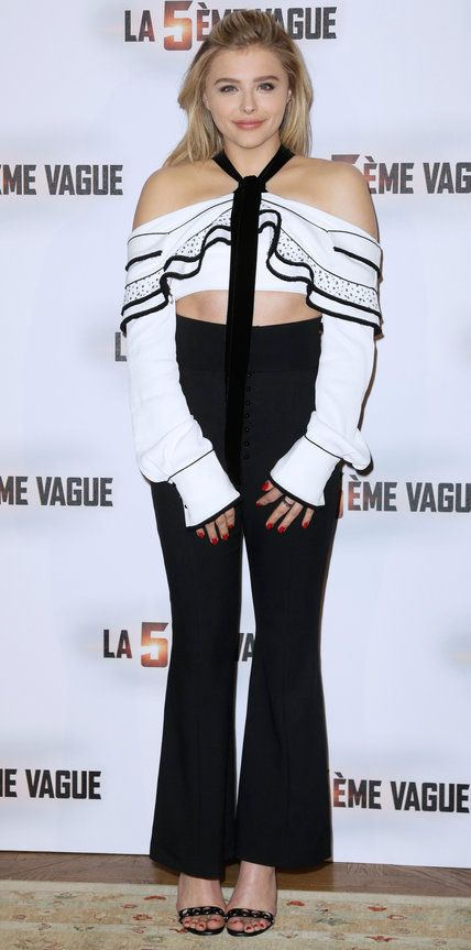 Chloe Grace Moretz delivered a dose of charm at The 5th Wave photocall in a sweet black-and-white ruffled ensemble by Proenza Schouler.