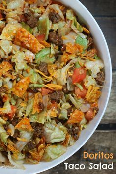 This Doritos Taco Salad is perfect for a potluck! Only 150 calories or 4 Weight Watchers SmartPoints per   serving!