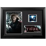 Thor Movie Series 4 Mini Cell -   This amazing Thor Movie Series 4 mini film cell features a print and an actual cell from Thor: The Mighty Avenger. Measures 5-inches tall x 7-inches wide. Perfect for displaying in your home or at the office, all the elements are framed in black wood and includes a certificate of authenticity....