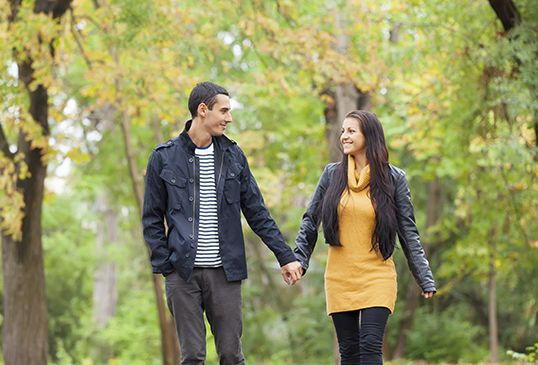 Ten couple at the park in autumn time