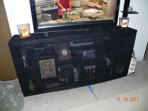 How to baby proof an entertainment center and keep some for Child proof living room ideas