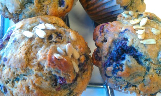 Fresh baked wheat muffins with berries & sunflower seeds...