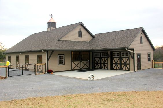 This stable yard is beautifully groomed to withstand the constant traffic of horses, and includes a small, attached garage for farm equipment. Charming!