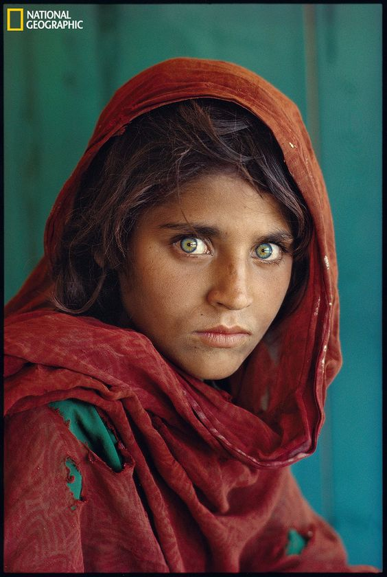 The Most Iconic Photographs From National Geographic's 125-Year History. Perhaps the most iconic National Geographic photo, Steve McCurry snapped this picture of an Afghan girl in a Pakistan refugee camp in 1984. It almost went unnoticed, until one editor rescued it from a pile and stuck it on the June 1985 Cover. Absolutely stunning photo. #nationalgeographic