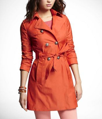 who doesn't love a good pop of color in an otherwise classic trench?