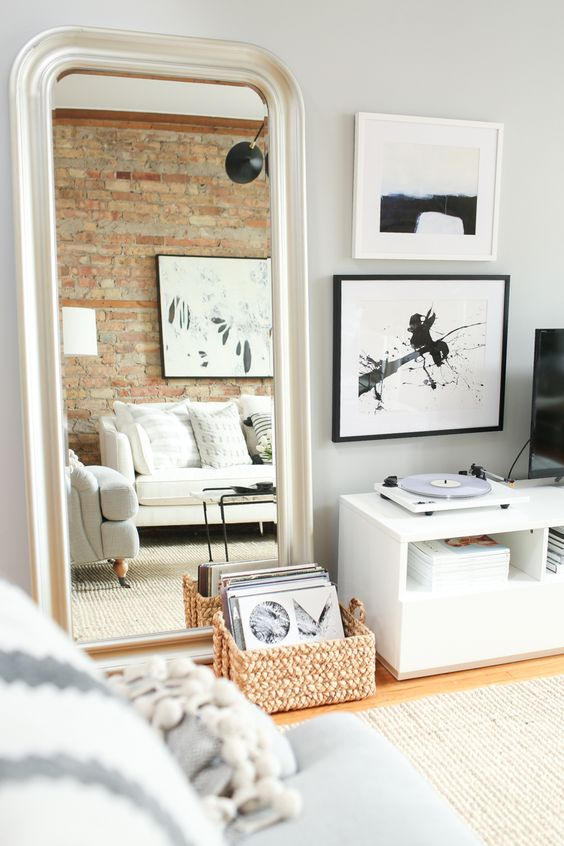 The Everygirl Co-founder Danielle Moss' Chicago Apartment Tour #theeverygirl || neutral interiors, white couch, jute rug, marble coffee table, exposed brick, floor length mirror