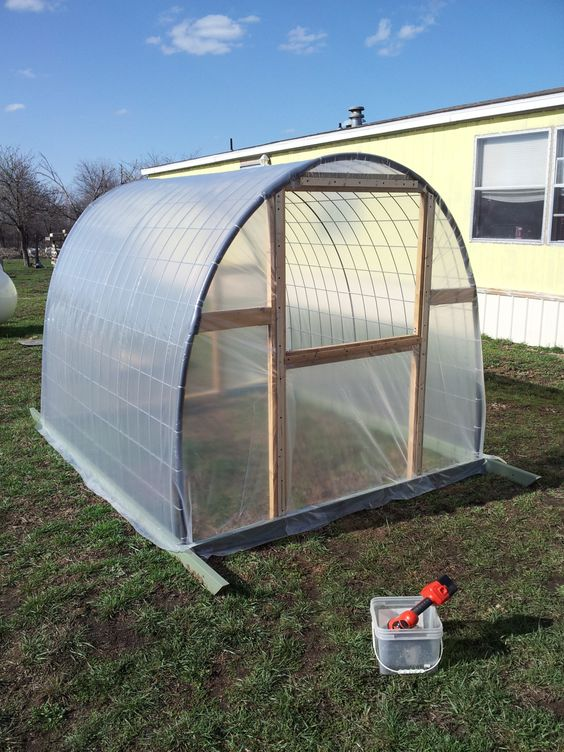 Diy poly tunnel greenhouse in the garden pinterest for Homemade greenhouse plastic