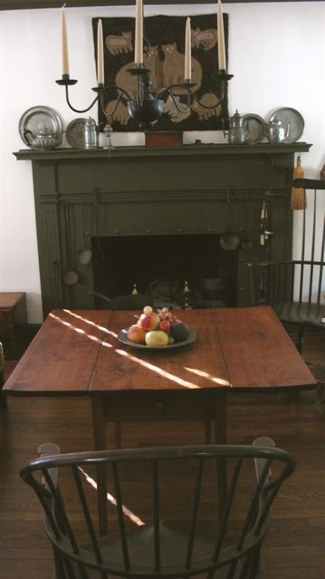 love this table, and the deep green fireplace mantle.. usually not a green girl!