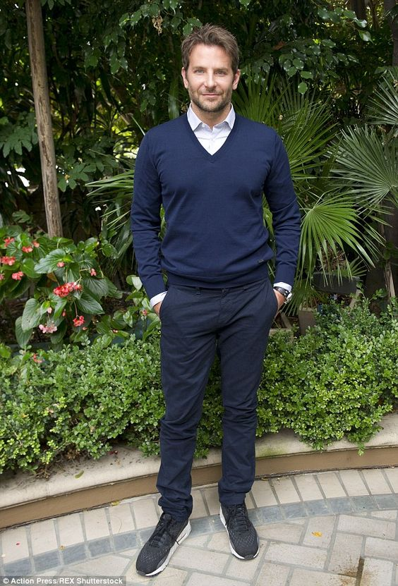 Matching: The pair wore matching royal blue jumpers with shirts to present their second pr...