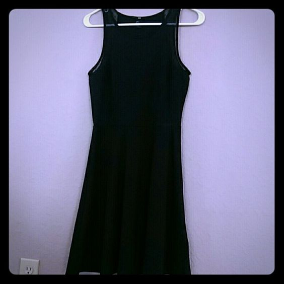 Black h&m skater dress Perfect little black skater dress. Cute detail around arm opening. Brought home and never wore had it hanging in my closet for a while now, time to pass it on to someone who will enjoy it H&M Dresses