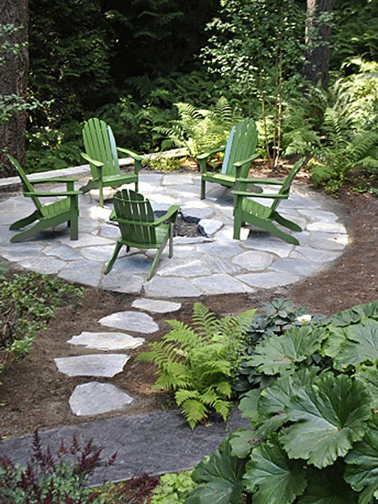 landscape design fire pits and green chairs on pinterest