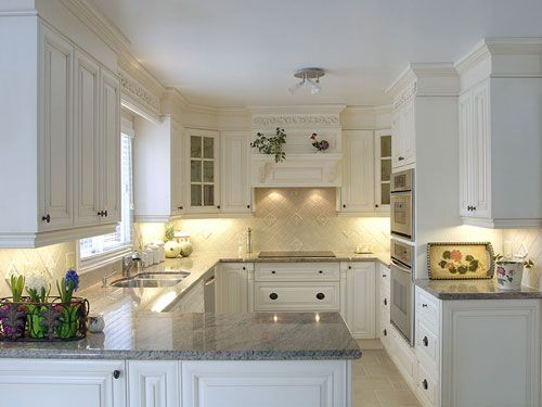 Kitchens with peninsulas kitchens and narrow kitchen on for White kitchen cabinets with crown molding
