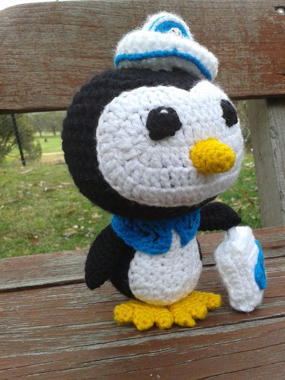 'Peso' the Penguin from 'Octonauts' - crochet. No pattern for this one - my project notes can be found here....they may help you; http://www.ravelry.com/projects/LindaDavie/peso-the-penguin---octonauts