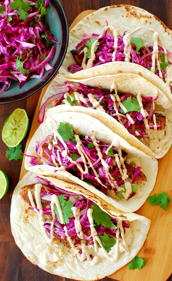 Fish tacos. Wicked good fish tacos, with Wicked good sauce. If you like fish tacos, you've got to try this! Get MaryJo's Original Recipe here. | joeshealthymeals.com
