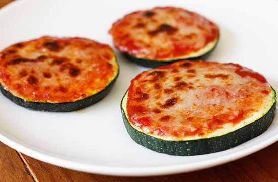 Love this low-carb way to get pizza. Zucchini Pizza Bites; 125 calories for 4 pieces