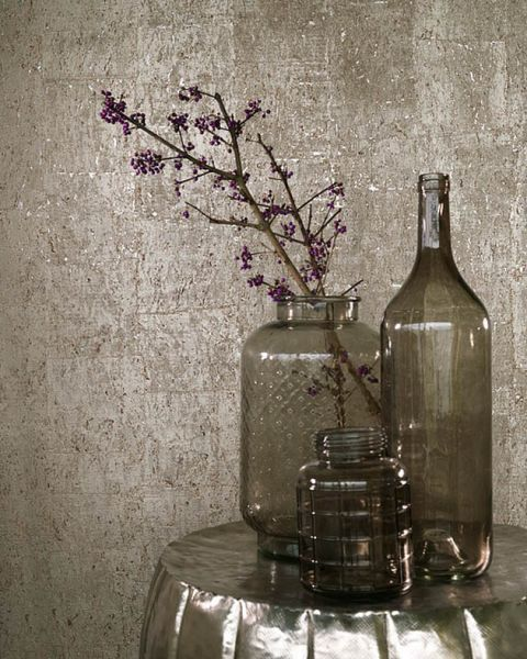 Cork from Brian Yates Vista 5 collection is made from real cork and is paper backed. This wallpaper features chipped away cork revealing an elegant metallic shimmer beneath, creating a luxurious interior. Available in 16 glimmering colourways.