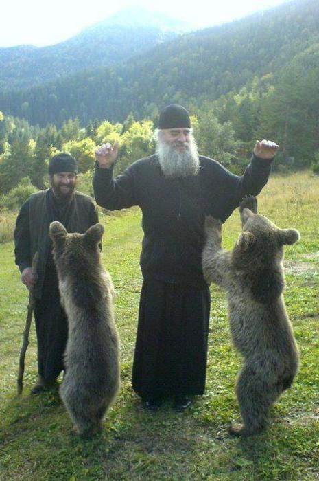 Orthodox monks with bear cubs..