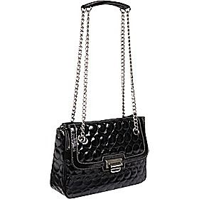 Charlize Theron jet sets with Jackson in style - Nine West's Quilty As Charged Shoulder Bag ($55.20)