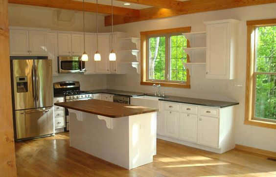 white kitchen cabinets with oak trim