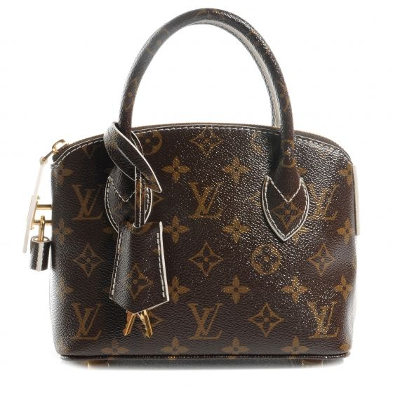 This is an authentic LOUIS VUITTON Monogram Fetish Lockit BB.   This petite lockit tote is crafted of glossy coated Louis Vuitton monogram coated canvas.