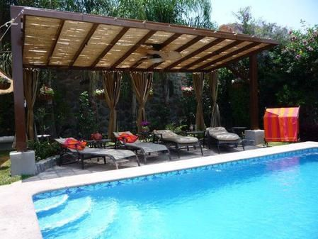 Plenty of lounge chairs, shade and privacy for your clothing optional experience.  http://www.AmigosCasa.net