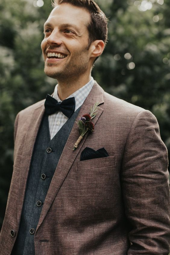 This groom's style is a classic mix of brown and dark grey with a modern twist in the grey checkered shirt and black bowtie | Image by Tree of Life Films & Photography