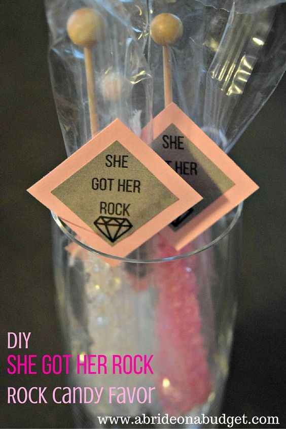 """Want a tasty (and easy) bridal shower or engagement party favor? Make our DIY """"She Got Her Rock"""" Rock Candy Favor from www.abrideonabudget.com. Even better, there's a free printable for the tags in the post too!"""