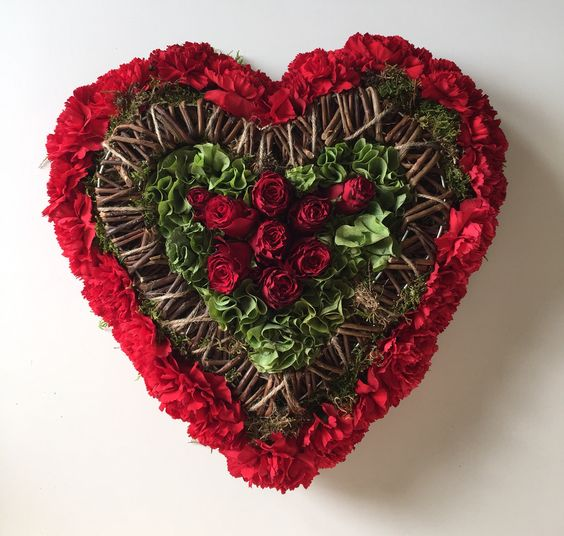 Textured heart using carnations, molucella, roses and wicker