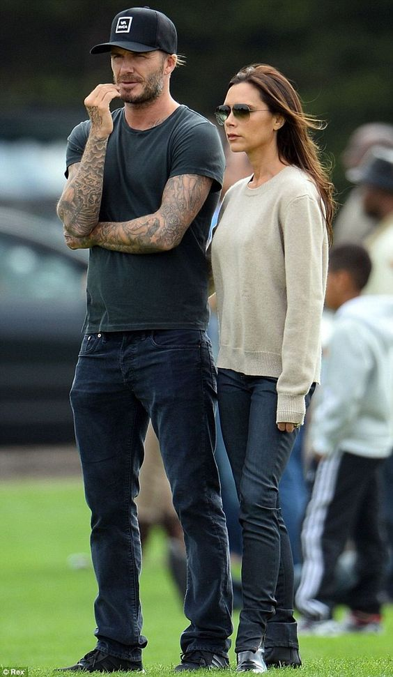 David and Victoria Beckham watch their sons play football at Hogwood Park training ground in Reading, Berkshire.  (September 2014)