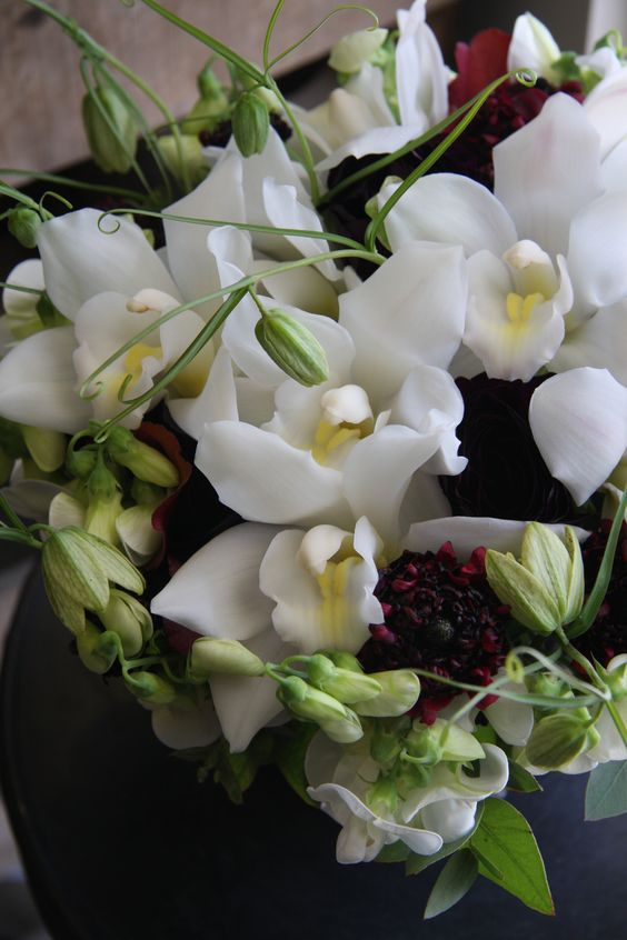 orchid,ranunculus and sweet pea