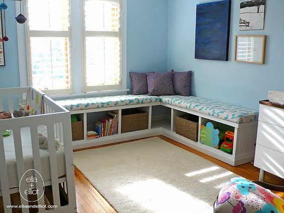 Take 2 Ikea Expedit bookshelves, lay on their sides with a cushion on top. Additional seating and a neat way to organize.