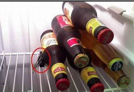 Use a clip to keep bottles from rolling in the fridge