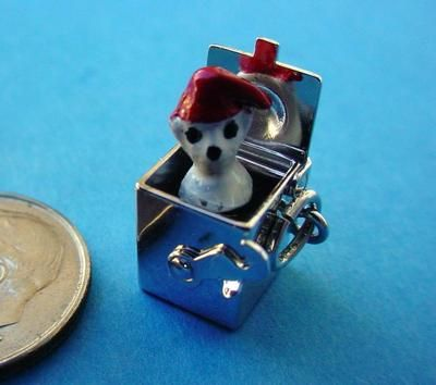 Jack in the box moveable charm (looks more like a dog in the box to me)