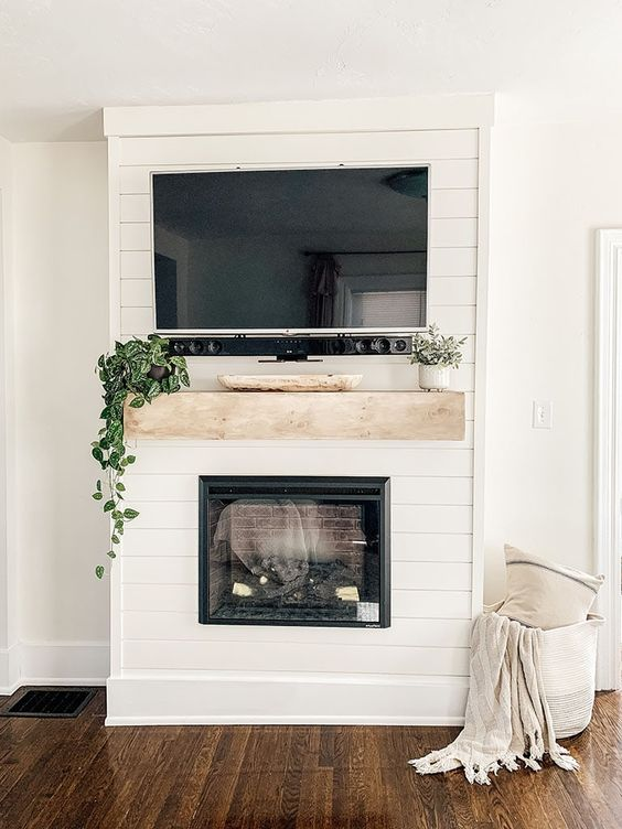 Step by step tutorial on how to build an inexpensive shiplap fireplace using an electric insert. Transform your boring TV wall into a statement piece. DIY Faux Fireplace | DIY Fireplace Mantel | DIY Fireplace With TV Above #homedecor #diyhome #modernfarmhouse #shiplap