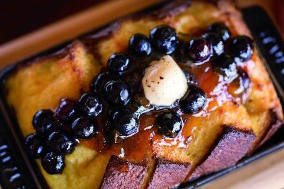 The French Toast Bread Pudding, served at State Fare Bar & Kitchen at The Ritz-Carlton, Rancho Mirage is made with brioche soaked in custard, whipped crème fraiche, blueberry apricot compote, and is topped with caramel sauce.