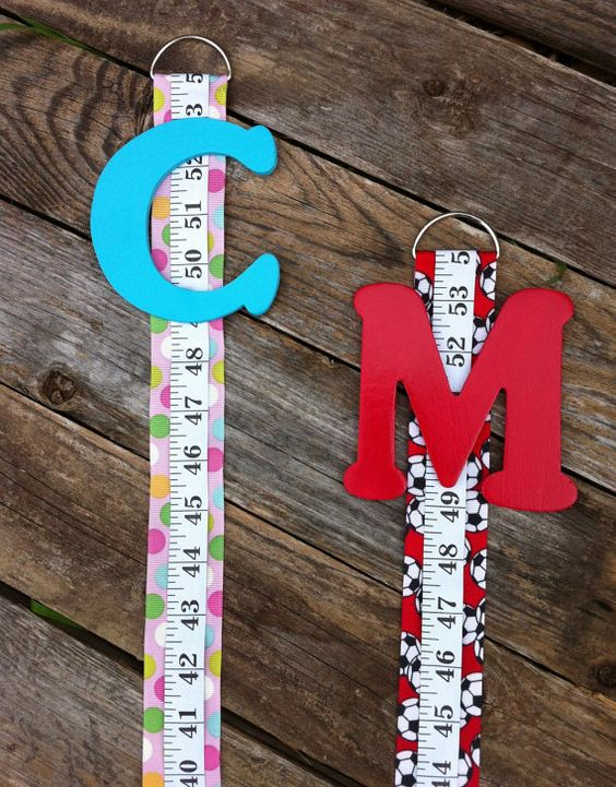 Growth Chart---ribbon, a fabric tape measure, one of those metal loop things, and a painted letter
