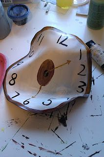 Salvador Dali clocks - using old vinyl records to melt and shape in the oven, then paint over to create the clock!