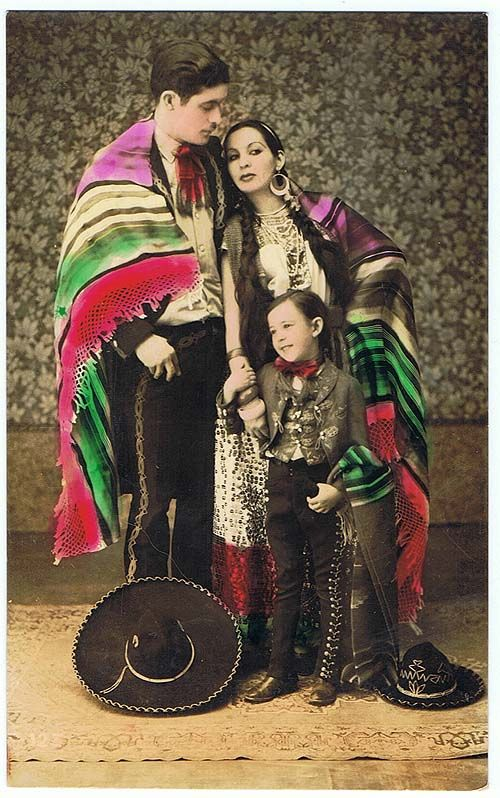 Old tinted Mexican postcard in Charro and China Poblana Dress.