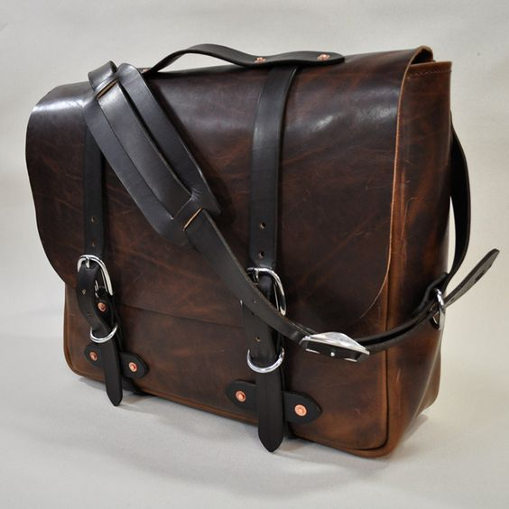 So this is picture of a guy's satchel, but it's still gorgeous. I love how stylish and yet practical satchels are, it's great that they're in fashion and therefore there are so many of them around. The faded brown of this one is nice, and I like the black straps. Looks a good size too.