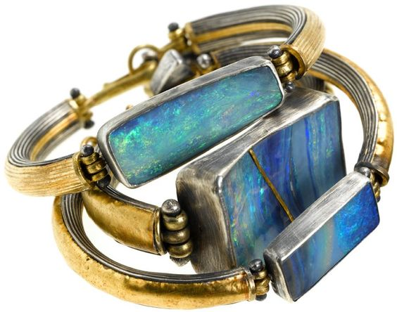 Opals set in bracelets with silver and gold by Judy Geib <3