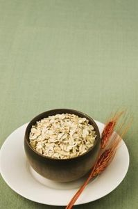 Save money and ensure the purity of your own instant oatmeal or oat flour. Instant oatmeal requires the least amount of cooking time, but packaged products can have salt, sugar or artificial flavorings added. Old-fashioned rolled oats are not nearly as convenient, and they require a longer time to cook. With a coffee grinder, blender or food processor, you can turn old-fashioned rolled oats into your own instant oatmeal or oat flour