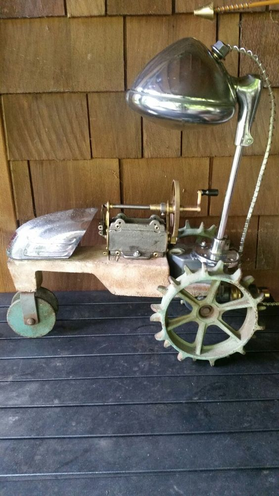 Table lamp made from an old Coleman tractor sprinkler, an old hand crank…