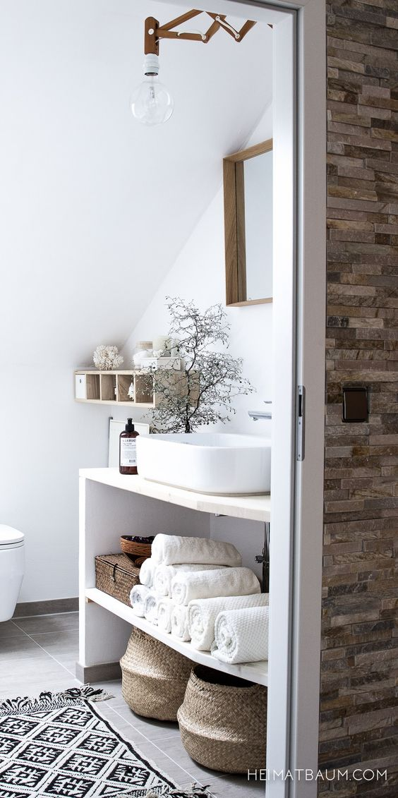 Bathroom, sink with space under on shelves ideal for towels and bathroom centrals: