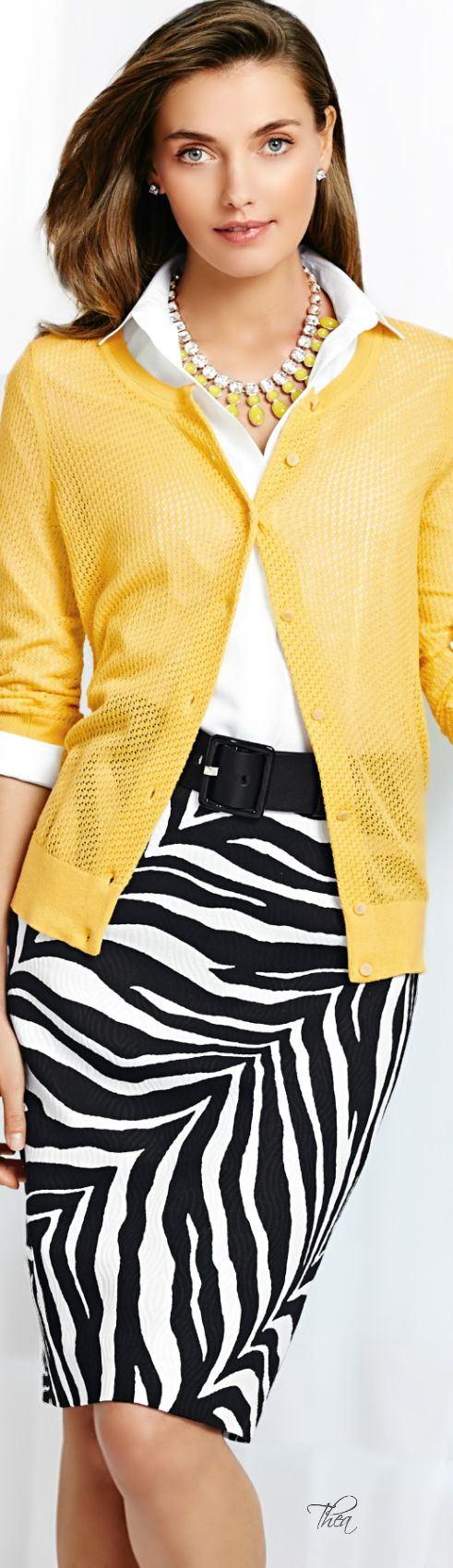 Zebra print skirt, white collar shirt, yellow cardigan, yellow and crystal necklace, crystal earrings: